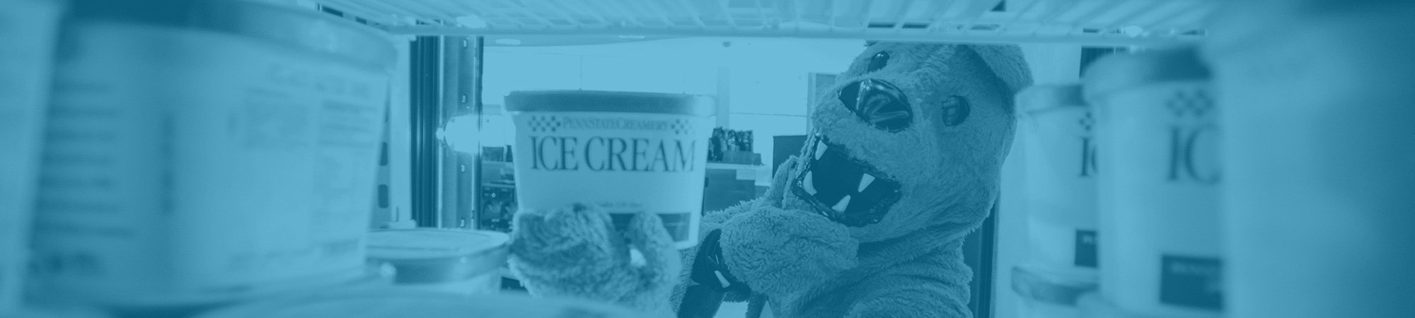Nittany Lion selecting ice cream from cooler