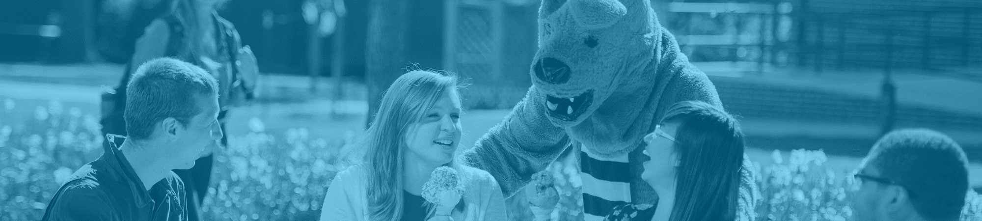 Nittany Lion and students with ice cream