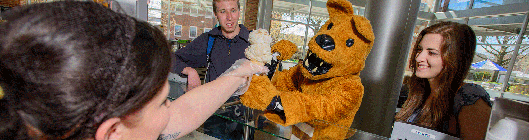 Lion and students getting ice cream